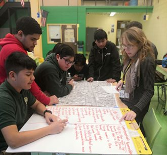 Students look at a map of Main Avenue in Passaic.