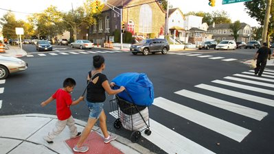 A family crosses a street in Red Bank